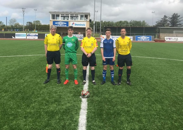 Kerry Captain Sean Carmody with Match Officials before the start of the SSE Airtricity U17 League game against Limerick Fc