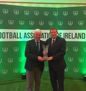 Kerry District s League Hon Secretary John O' & Chairman Sean O'Keeffe accepting the FAI Best Publication Award.